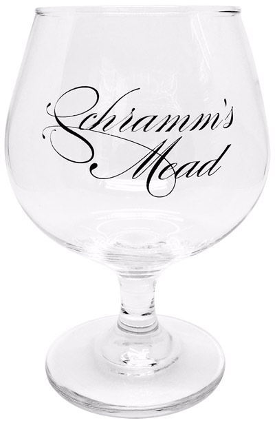 An empty snifter of Schramms Cranberry Mead